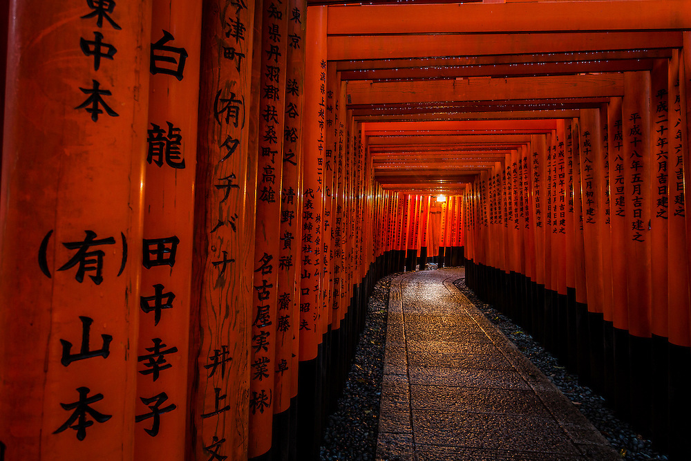 The proximity of each of the gates in the first set of Tori at Fushimi Inari Shrine causes the impression of walking through a red tunnel