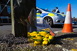 A bouquet of yellow tulips lies at the police cordon near to the scene of where an alleged burglar is thought to have died after 78 year-old pensioner Richard Osborn-Brooks is alleged to have stabbed one of two intruders who targeted his home. London, April 05 2018.