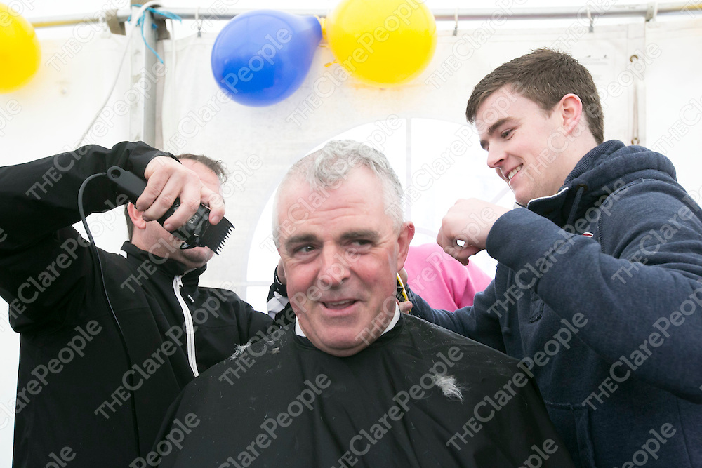 Clare Manager Davy Fitzgerald &amp; Clare Tony Kelly shaving the Head of Superintendent John Kerin  at  the Garda Shave or Dye event in O'Connell Square Ennis. .<br /> Pictured Credit Brian Gavin Press 22