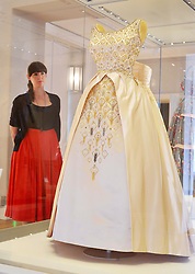 Fashion Rules, major new exhibition of Royal clothing.<br /> Dress from the collections of HM The Queen, Princess Margaret and Diana, Princess of Wales.  Major new exhibition focusing on 20th century Royal clothing. Sponsored by Estee Lauder Companies. Exhibition opens tomorrow.<br /> -HM The Queen. Evening gown, Norman Hartnell 1963.  Worn for opening of the New Zealand parliament, during Commonwealth visit, 1963, Kensington Palace, <br /> London, United Kingdom<br /> Wednesday, 3rd July 2013<br /> Picture by Nils Jorgensen / i-Images