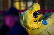 Hazmat crews clean up hazardous material outside the apartment of Nina Pham, a nurse at Texas Health Presbyterian who became the first person to contract the Ebola virus in the United States after caring for Thomas E. Duncan in Dallas, Texas on October 12, 2014.
