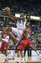 November 27, 2009; Sacramento, CA, USA;  Sacramento Kings guard Tyreke Evans (13) shoots past New Jersey Nets guard Devin Harris (34) during the third quarter at the ARCO Arena. Sacramento defeated New Jersey 109-96.
