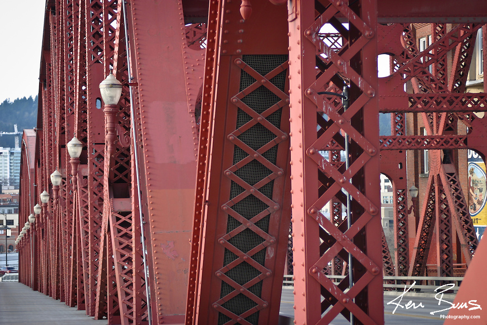 The detailed metalwork of the Broadway Bridge, which spans the  Willamette River in Portland, Oregon