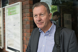 © Licensed to London News Pictures. 16/09/2016. Watford, UK.  David Payne from Berkhamstead is amongst the passengers waiting to be collected outside Kings Langley rail station following the derailment by a landslide of a train bound for London Euston. They were transferred from the derailed train to a rescue train and exited at Kings Langley.  Apart from one person who suffered whiplash, there were no other reported injuries. Photo credit : Stephen Chung/LNP