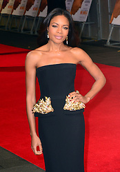 Naomie Harris attends The Royal Film Performance of Mandela Loing Walk To Freedom Film Premiere at Odeon Leicester Square, London, United Kingdom. Thursday, 5th December 2013. Picture by Nils Jorgensen / i-Images