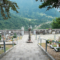 LONGARONE, ITALY - SEPTEMBER 26:  A general view of the Erto Cemetery seen on  September 26, 2013 in Longarone, Italy. The Vajont  tragedy happened on the night of the 9th October 1963, when a landslide broke away from Mount Toc and fell into the Vajont river causing a wave that struck the neighboring towns, the devastation was total, more than 2000 people died and only few lucky villagers survived.  (Photo by Marco Secchi/Getty Images)