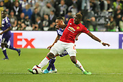 Paul Pogba Midfielder of Manchester United is tackled by Anderlecht Midfielder Youri Tielemans during the UEFA Europa League Quarter-final, Game 1 match between Anderlecht and Manchester United at Constant Vanden Stock Stadium, Anderlecht, Belgium on 13 April 2017. Photo by Phil Duncan.