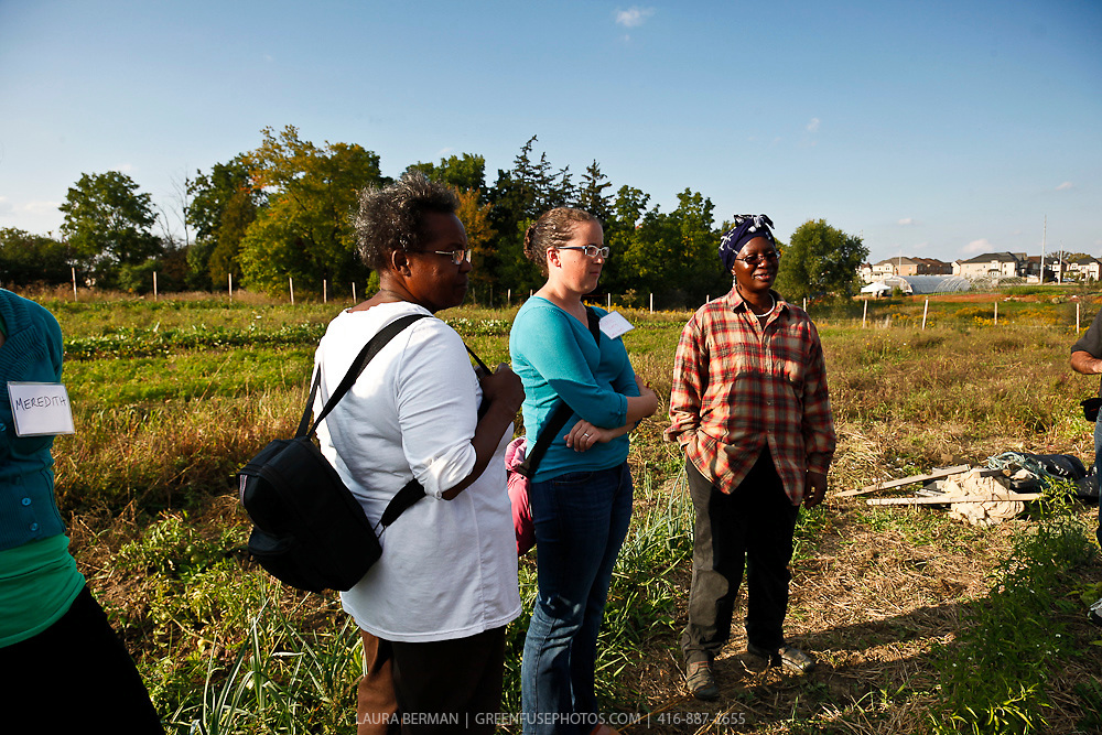 Tour participants talk with Margaret Zondo of Southern Horizons market garden at FarmStart's McVean Incubator farm, final stop on the World Crops Project City to Country tour.