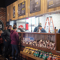People line up to order for the grand opening of Dickey's Barbaque Pit on Dec. 21, 2018 in Gallup.