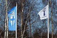 01.05.2010, Tapiolan Urheilupuisto, Espoo..Veikkausliiga 2010, FC Honka - IFK Mariehamn..Palloliiton ja Veikkausliigan liput liehuvat tuulessa..©Juha Tamminen.