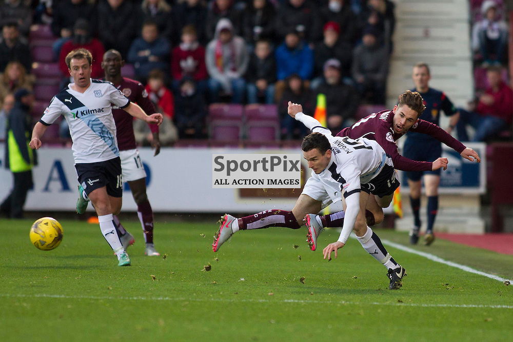 Paul McGinn of Dundee and Sam Nicholson of Hearts battle for the ball during the Ladbrokes Scottish Premiership match between Heart of Midlothian FC and Dundee FC at Tynecastle Stadium on November 21, 2015 in Edinburgh, Scotland. Photo by Jonathan Faulds/SportPix