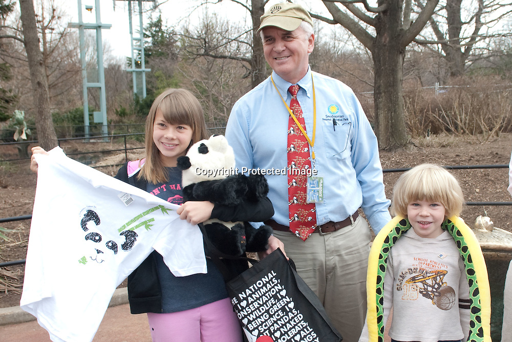 "(*Handout*) MAR-11-2010: Bindi(L), and Robert Irwin(R) receive a gift bag from National Zoo animal care director Don Moore during a promotional event for Bindi's upcoming ""Free Willy 4: Escape from Pirate's Cove"" movie at the National Zoo in Washington DC on March 11, 2010. Photo by Kris Connor for Warner Bros."