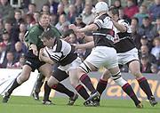 Sport - Rugby 27/04/2002 Parker Pen Shield - Semi-Final.London Irish vs Pontypridd - Kassam Stadium - Oxford.Justin Bishop holds up Ceri Sweeney..[Mandatory Credit, Peter Spurier/ Intersport Images].