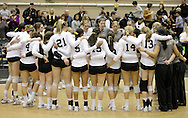 West Point, NY - Army players and coaches gather in a circle on the court after defeating Lehigh in a Patriot League women's volleyball tournament match at the United States Military Academy on Nov. 21, 2009.