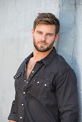 portrait of a hot man with blue eyes and brown hair