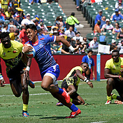 Alamanda Motuga breaks through a crowd for Samoa's last try as Samoa beat Uganda 45-7 at the World Cup 7's USA, AT&T Park, San Francisco, California, USA.  Photo by Barry Markowitz, 7/20/18, 2:35pm