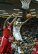 January 04 2010: Iowa Hawkeyes guard Bryce Cartwright (24) puts up a shot past Ohio State Buckeyes forward Deshaun Thomas (1) during the first half of an NCAA college basketball game at Carver-Hawkeye Arena in Iowa City, Iowa on January 04, 2010. Ohio State defeated Iowa 73-68.