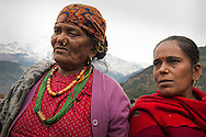 — The grand matriarch of this Gurung village (Priya's grandmother) and her daughter tell stories of young people who have left the village to seek their fortunes in the modern world. They tell us how the remittance payments these workers send home have become one of the family's main sources of income.