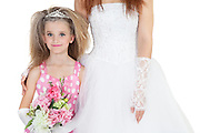 Portrait of beautiful bridesmaid holding flower bouquet standing next to bride