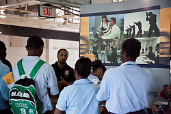 Special Agent Edward Henderson of the Drug Enforcement Agency speaks with students from Charlotte Amalie High School.
