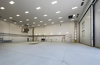 Interior and exterior photography of Building AS 514 Corrosion Control Hangar at Camp LeJeune MCAS New River