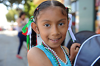 """Gabriela Florencia Arellano, 6, was in a patriotic mood for Sunday's """"El Grito"""" celebration in Salinas marking September 16th's anniversary of Mexico's independence from Spain. The annual fiesta, which occupies East Alisal Street between Wood and Sanborn, brimmed as usual with booths selling souvenirs and all manner of food and drink. Local businesses and nonprofits manned booths with information about health and community programs, while traditional """"bandas"""" filled the afternoon with dance music and good cheer."""