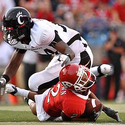 Sep 7, 2009; Piscataway, NJ, USA; Rutgers wide receiver Tim Brown (2) is downed by Cincinnati linebacker Walter Stewart (54) during the second half as Cincinnati defeats Rutgers 47-15 in NCAA Big East college football at Rutgers Stadium.