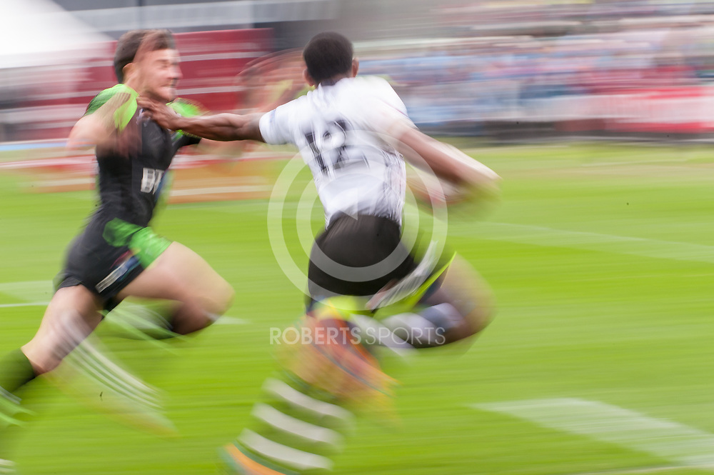Fiji's Vatemo Ravouvou holds off a Welsh defender to score a try. Action from the IRB Emirates Airline Glasgow 7s at Scotstoun in Glasgow. 3 May 2014. (c) Paul J Roberts / Sportpix.org.uk