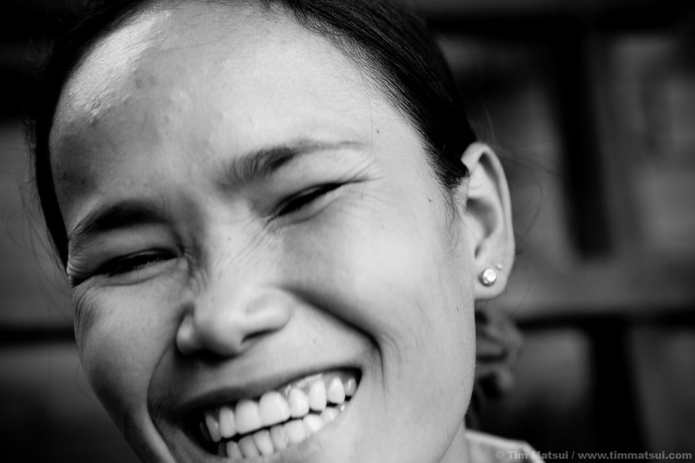 """Srey Leat, a prostitute living in a slum where """"Acting for Women in Distressing Situations"""" (AFESIP) conducts outreach and provides services, in Phnom Penh, Cambodia. Srey Leat, 24, is a victim of sex trafficking and has been prostituting for three years. The slum's permanent structure, a decaying four story building known simply as 'The Building', was built in the 1960's as transitional housing and now hosts a shantytown where many of the city's poor live, including many prostitutes, and is believed to have the highest rate of HIV infection in the city. AFESIP hands out free condoms, instructs prostitutes on HIV prevention, and conducts outreach in case the prostitutes need medical services, choose to leave their profession, or can report on cases of sex trafficking. AFESIP offers housing, education, training, and counseling for women who are victims of sex trafficking, worked as prostitutes, or are escaping domestic violence. Founded by Somaly Mam, who herself was once a prostitute and victim of trafficking and domestic abuse, AFESIP has three facilities in Cambodia and works with other NGO's to provide long term care for the women."""