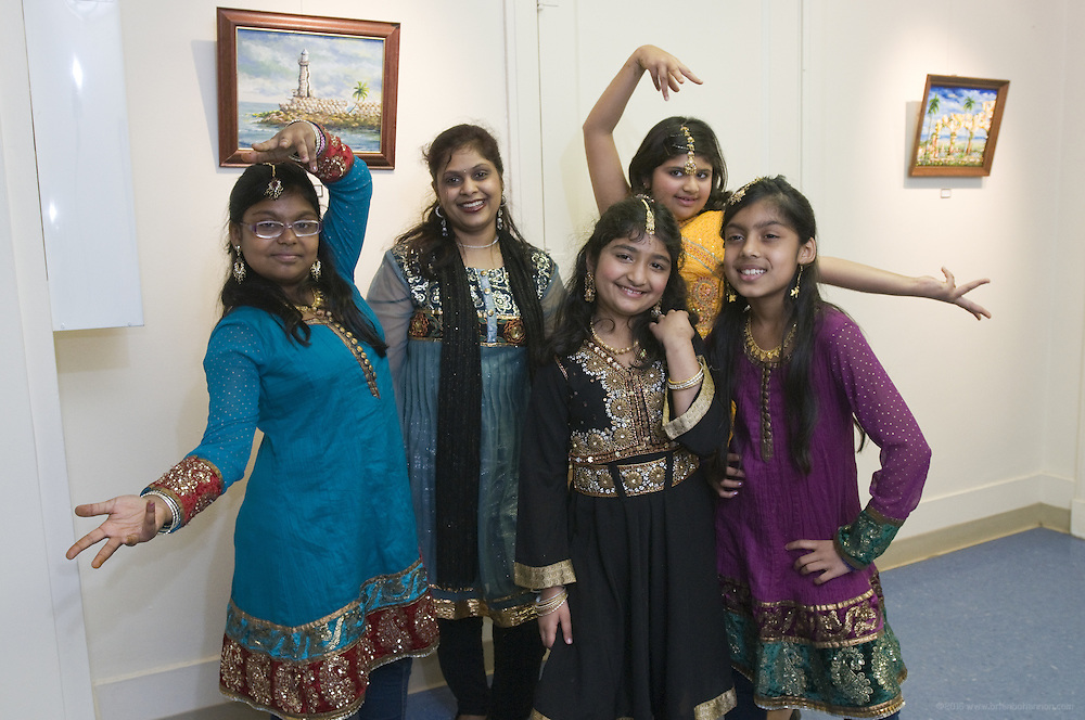 Dancer Vindhya Katta teacher of Nachale: The Bollywood Dance Workout poses with students Kavya Nair, 10, left, Preeti Tanwani, 8, center, Arika Diwedi, 10, and Shloka Nair, 9, after the English Conversation Club: Dance and Dialogue event Saturday April 9, 2011 at the Iroquois Branch of the Louisville Free Public Library in Louisville, Ky. Henna and Bindi followed the Bollywood dance lesson, and then volunteers were paired with English language learners to work on conversation skills. (Photo by Brian Bohannon)
