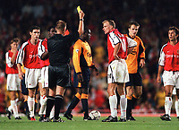 Referee Graham Poll shows the 2nd yellow and red card to Patrick Vieira as Dennis Bergkamp looks on is disbelief. Arsenal 2:0 Liverpool, F.A.Carling Premiership, 21/8/2000. Credit : Colorsport / Stuart MacFarlane.