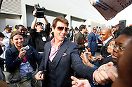 Actor Tom Cruise greats fans a stop in Harlem on a promotional tour of New York for his new movie 'Mission Impossible 3' , Wednesday 03 May 2006. Cruise is attending a number of different events around the city and travelling by a number of different forms of transportation.