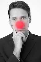 Businessman Wearing Clown Nose