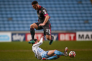 Coventry City defender Cian Harries (29)  tackles Morecambe  forward, on loan from Tranmere Rovers, Cole Stockton (23)  during the The FA Cup match between Coventry City and Morecambe at the Ricoh Arena, Coventry, England on 15 November 2016. Photo by Simon Davies.