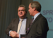 © Licensed to London News Pictures. 23/03/2013. Exeter, UK .Radio presenter Jon gaunt  shakes hands with Nigel Farage, leader of the party after he announces he is joining UKIP.  The UK Independence Party (UKIP) 2013 Spring Conference is held at the Great Hall, Exeter University today, Saturday 23rd March 2013. Support for the party is rising after success in the recent Eastleigh by-election, where UKIP came second behind the Liberal Democrats. Photo credit : Stephen Simpson/LNP