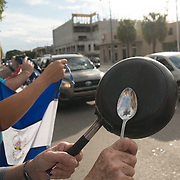 MIAMI, FL - NOVEMBER 26: Pots, pans and flags as Miami residents react to the news of the death of former Cuban President Fidel Castro Ruz. Many, mostly Cubans, gathered outside popular Miami restaurant Versailles to wave flags and celebrate the news, on NOVEMBER 26, 2016 in Miami, Florida. (Photo by Angel Valentin/Getty Images)