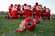 Football players huddle together for a prayer Sept. 30, 2011 before the start of their Homecoming game in Premont. Never a football powerhouse, Premont players said they felt a strong need to win this game and give their town hope amid all the uncertainty.