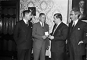 20/02/1964<br /> 02/20/1964<br /> 20 February 1964<br /> Presentation of World Wines and Liquor Olympics award to John Power and Son Ltd at the John's Lane Distillery. The prize was awarded for their Sarotov Vodka which received the Premier Award in its Category in the World Wines and Liquor Olympics.<br /> Picture shows M. andre L. de Vogelaere (2nd from right), Counsellor of the Belgian Embassy presenting the medal to Mr P.A. Leavy, Sales Manager John Power and Son Ltd. On the left is Mr F.J. O'Reilly, Chairman and Managing Director and on the right, Mr John A. Ryan, Joint Managing Director of John Power and Sons Ltd.