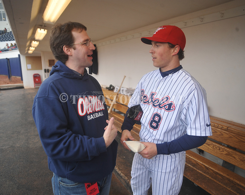 Ole Miss baseball contact Bill Bunting (left) visits with former player Chris Coghlan of the Florida Marlins at Ole Miss baseball alumni game at Oxford-University Stadium in Oxford, Miss. on Saturday, February 5, 2011.