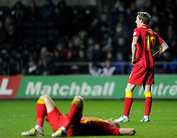 James Collins (West Ham United) of Wales and Andy King (Leicester City) of Wales are devastated after conceding a late goal to loose the game - Photo mandatory by-line: Joe Meredith/JMP - Tel: Mobile: 07966 386802 26/03/2013 - SPORT - FOOTBALL -  Liberty Stadium - Swansea -  Wales V Croatia - WORLD CUP QUALIFIER