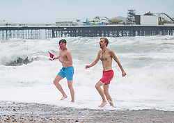 © Licensed to London News Pictures. 25/12/2017. Brighton, UK. Dozens of members of the public take part in the 2017 Christmas Day swim in the Brighton and Hove sea. Photo credit: Hugo Michiels/LNP