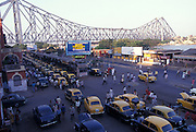 Howrah Bridge and taxis outside Howrah Station,  Calcutta