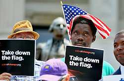 "Supporters stand during a news conference to announce the delivery of 626,000 signatures to Gov. Nikki Haley calling for the removal of the Confederate battle flag. The Senate voted 36-3 in favor of removing the Confederate battle flag from State House grounds Tuesday, July 7, 2015 in Columbia. zlaup ""Confederate Flag"""