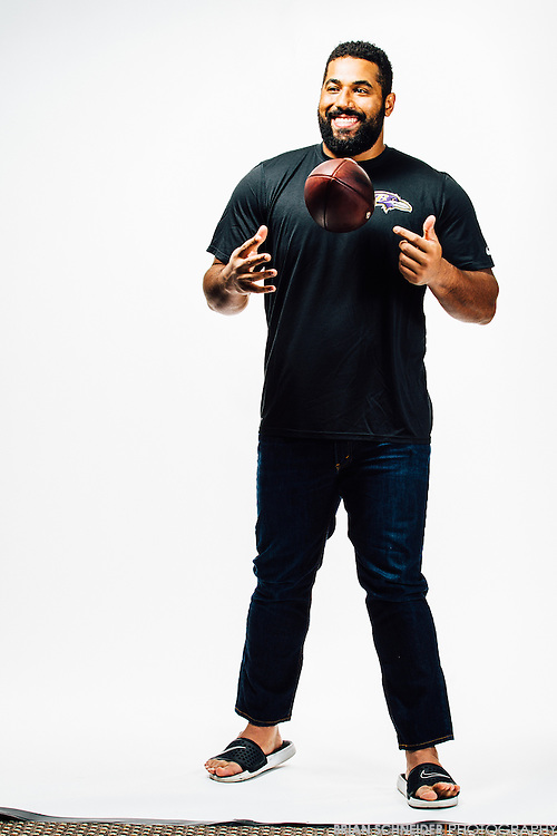 Oct 23, 2015; Baltimore, MD, USA; Baltimore Ravens offensive lineman John Urschel poses for a portrait on seamless for Baltimore Magazine. Urshel graduated from Penn State with a 4.0 in both his bachelor and masters Mathematical Science degrees. Mandatory Credit: Brian Schneider-www.ebrianschneider.com