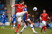 Coventry defender Aaron Martin and Gillingham forward Dominic Samuel fight for the ball during the Sky Bet League 1 match between Gillingham and Coventry City at the MEMS Priestfield Stadium, Gillingham, England on 2 April 2016. Photo by David Charbit.