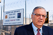 "27 FEBRUARY 2012 - PHOENIX, AZ:    Maricopa County Sheriff JOE ARPAIO talks about the new sign he unveiled at ""Tent City"" in the Maricopa County Jail system. The new sign announces the number of inmates who have ""served"" time in the county jail's tents. Sheriff Arpaio opened ""Tent City"" with surplus US Army tents from the Korean War in 1993. The tents, which are not air conditioned, house about 2,000 county inmates at any given time. Monday's announcement is the kickoff event of the Sheriff's celebration of 19 years of Tent City. The sign Arpaio  announced Monday is based on the sign a popular fast food chain used to use to mark the number of hamburgers served.  PHOTO BY JACK KURTZ"