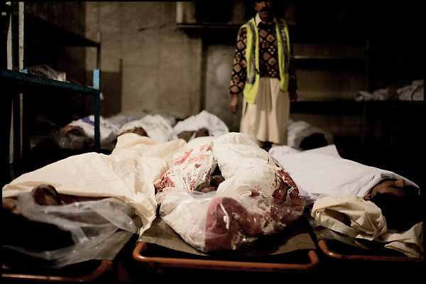 """Dead bodies in the morgue of the Edhi Foundation. Every day arrive at the Clinic bodies of addicts died from drug-related issues. Karachi, Pakistan, on sunday, December 07 2008.....""""Pakistan is one of the countries hardest hits by the narcotics abuse into the world, during the last years it is facing a dramatic crisis as it regards the heroin consumption. The Unodc (United Nations Office on Drugs and Crime) has reported a conspicuous decline in heroin production in Southeast Asia, while damage to a big expansion in Southwest Asia. Pakistan falls under the Golden Crescent, which is one of the two major illicit opium producing centres in Asia, situated in the mountain area at the borderline between Iran, Afghanistan and Pakistan itself. .During the last 20 years drug trafficking is flourishing in the Country. It is the key transit point for Afghan drugs, including heroin, opium, morphine, and hashish, bound for Western countries, the Arab states of the Persian Gulf and Africa..Hashish and heroin seem to be the preferred drugs prevalence among males in the age bracket of 15-45 years, women comprise only 3%. More then 5% of whole country's population (constituted by around 170 milion individuals),  are regular heroin users, this abuse is conspicuous as more of an urban phenomenon. The substance is usually smoked or the smoke is inhaled, while small number of injection cases have begun to emerge in some few areas..Statistics say, drug addicts have six years of education. Heroin has been identified as the drug predominantly responsible for creating unrest in the society."""""""