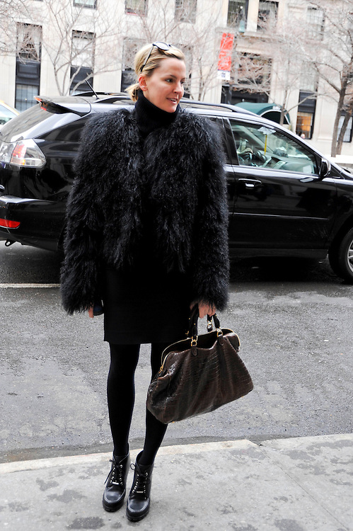 Treena Lombardo of W Magazine in a black fur jacket at the Oscar de la Renta Fall Winter 2010 show.