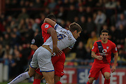 York City forward Vadaine Oliver & AFC Wimbledon defender Paul Robinson tangle during the Sky Bet League 2 match between York City and AFC Wimbledon at Bootham Crescent, York, England on 24 October 2015. Photo by Simon Davies.