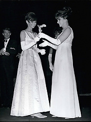 Oct. 29, 1965  - Cinema Night: Gina Lollobrigida distributes Oscars à ictory' Oscars awarded to screen actors and actresses were distribute to the winners during the  Cinema Night' held at Marigny Theatre, Paris, last night. OPS: Gina Lollobrigida handing a victory Oscar to Audrey Hepburn. Oct. 29/65 (Credit Image: © Keystone Pictures USA/ZUMAPRESS.com)